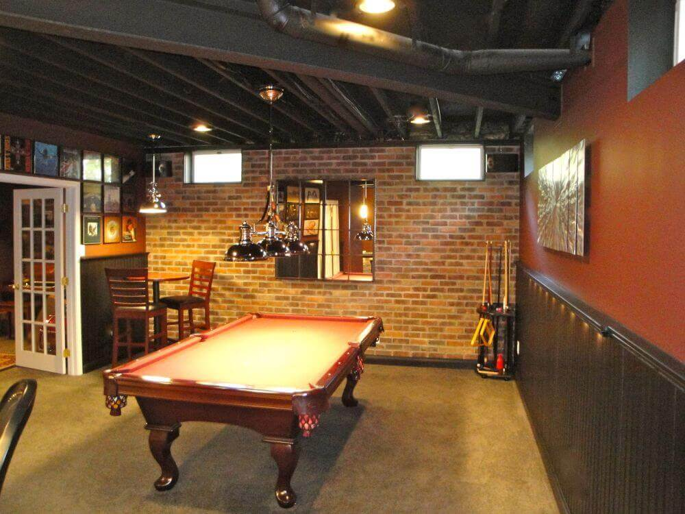 7way-rustic-basement-man-cave-billiards-room-with-brick-wall-and-exposed-wood-beams