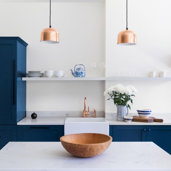 blue cabinets and rose gold accents kitchen