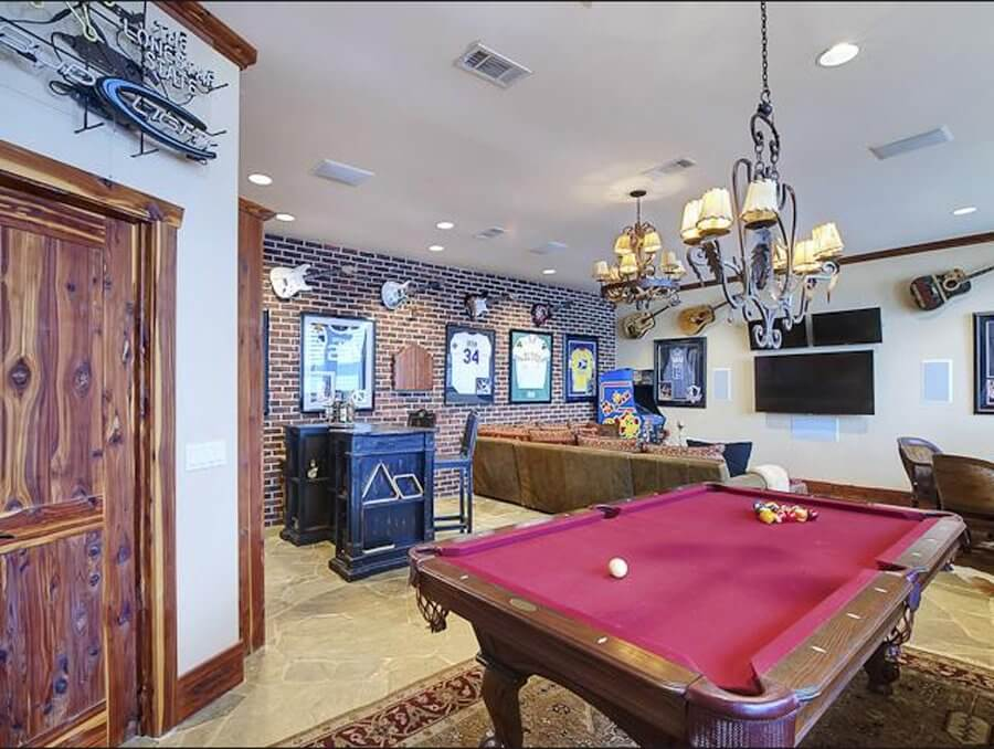 the-country-style-man-cave-in-this-graford-tex-home-features-a-relaxed-setting-where-you-can-kick-back-with-a-beer-and-admire-the-cool-guitars-on-the-wall-in-between-plays